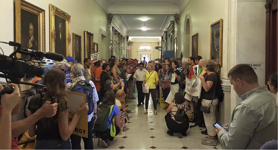 Climate and immigrants rights communities combined forces to demand real reforms outside of House Ways and Means Chairman Jeff Sanchez's office in Massachusetts.
